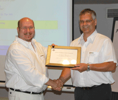Dr. Tim (left) receiving recognition from the Society of Manufacturing Engineers, Toronto Chapter 26. Dr. Juergen Boenisch (right) is Chair. 2008.