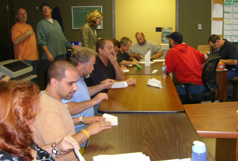 Lean game participants in a manufacturing setting.